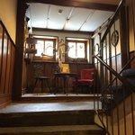 A view of the Staircase. Old furniture and items are tastefully arranged for the old world charm