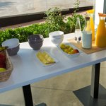 reads,The breakfast with plenty of fresh fruit, cheeses, pastries all very fresh