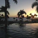 Infinity pool near upper bar at sunset.