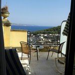 Beautiful view from our room with big terrace, two chairs, sunbeds, umbrella. Umbrella and sunbe