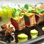 Grilled tuna with star anise, daikon, green peas & wasabi