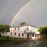 A summer storm and rainbow frame the old Inn