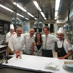 My wife and I with our waiter and the Chefs of Il Buco