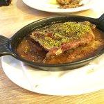 Roasted garlic encrusted lamb in onion based stew