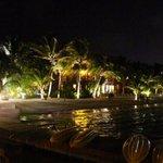 Ramon's Village lights up the beach at night.