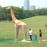 Giant Giraffe sculpture on the lawn.