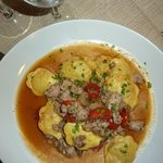Ravioli with mushrooms and sausage