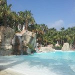view from a sunlounger, stunning pool
