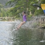 Emily, age 10, takes a plunge into the Frio river