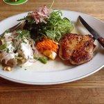 Pork steak with baked potato and salad. Lekker!