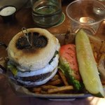 The presentation, branded burger and pesto fries