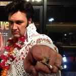 Elvis in the lobby after show posing for pics