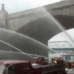Fire trucks releasing water into the Susquehanna