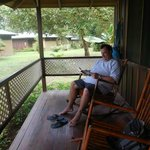 My cousin, Mike sitting on our porch at the Lodge.