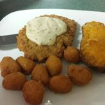 Delicious country fried steak with white gravy, corn nuggets, and a twice baked potato.