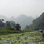 By rowboat towards the Perfume Pagoda