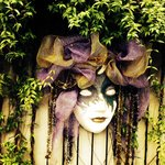 Mask on the wall outside