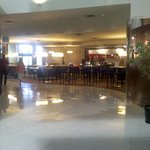 Open airy lobby and Starbucks