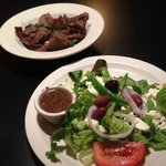 """Side"" of gyro meat and Greek salad with meal."