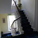 The stairwell, complete with tartan carpet and nicely turned banister
