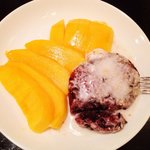 Sweet sticky rice with savory coconut sauce and mango. Salt/sweet bliss