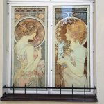 Windows of two Alfons Mucha paintings.