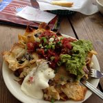 'Ugly gooey nachos' or something like that.  Excellent! Made with Sesame tortilla chips.