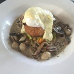Sweet potato cake, poached egg, and mushrooms.