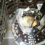 Looking down from hallway of rooms to the atrium