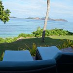 View from our beachfront room - comfy sun lounges
