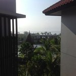 view of hotel Temple, Balanese gardens, Indian ocean from 4th floor