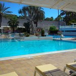 swimming pool with fixed overhead sun screening