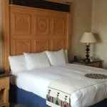 King size bed and pillows are comfortable in this stylish pueblo theme room.