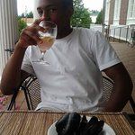 DaSean having a Speakeasy dinner on the porch of The Mimslyn Inn