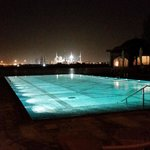 Outside view on pool and Grand Mosque at night in the distance