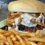 Smoked Beef Brisket Sandwich with Melted Mozzarella, Horseradish Sauce and Fried Onion Rings