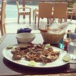 Piri piri oysters sprinkled with paprika.