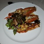 grilled jumbo prawns with an olive and caper butter accompaniment