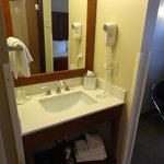 This vanity is directly opposite the bathroom door and inside the room door.