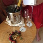 champs and strawberrys laced with chocolate birthday surprise for birthday boy from olympic lago