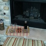 Wine and dessert in front of fireplace
