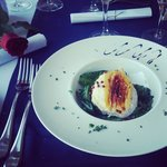 warm goats cheese and spinach salad in the mediterranean restaurant. rose and cava received on e