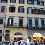 Entrance between restaurants, crazy hubby in window and waiter