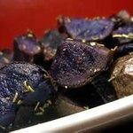 Crisp-edge perfectly seasonsed local blue potatoes.