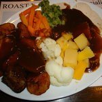 Roasted chicken breast with sauce, vegetables and potatoes