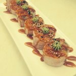 Spicy Salmon Rolled with rice paper,inside with scallion and carrots top wasabi and special hous