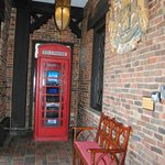 telephone booth near entrance of hotel
