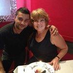 Our wonderful waiter and birthday dessert!