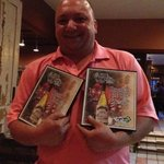 Nick Patillo holding two awards won at the Wine in the Wild event at the Buffalo Zoo today.