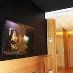 TV and hallway inside room.